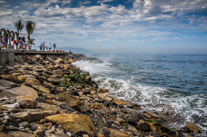 Fine Art Landscape Photograph. Ocean waves crashing in on the rocks in Banderas Bay, Puerto, Vallarta, Mexico.