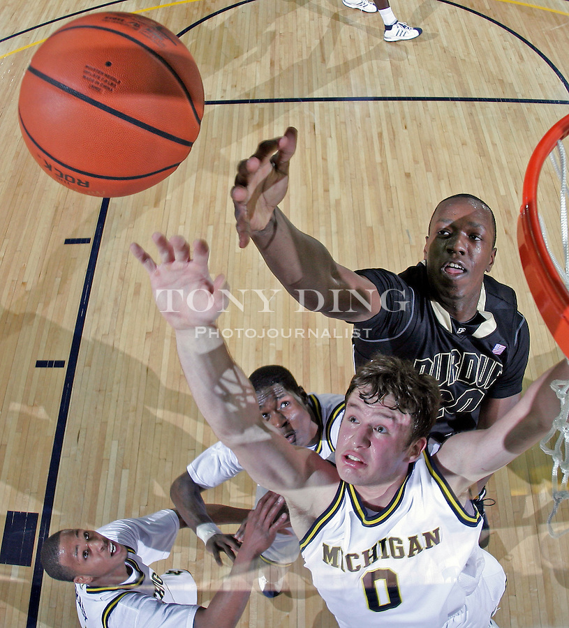 Michigan guard Zack Novak (0) competes for a rebound with Purdue guard Marcus Green, top, in the second half of an NCAA college basketball game, Thursday, Feb. 26, 2009, in Ann Arbor, Mich. Michigan upset No. 16th ranked Purdue 87-78. (AP Photo/Tony Ding)