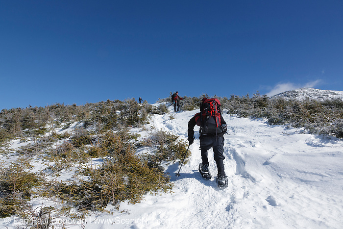 Hikers ascending Greenleaf Trail in the White Mountains, New Hampshire USA during the winter months. This hiking trail leads to the summit of Mount Lafayette on Franconia Ridge.