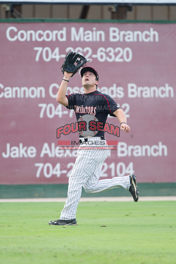 Kannapolis Intimidators left fielder Nolan Early (9) tracks a fly ball during the game against the Lakewood BlueClaws at CMC-NorthEast Stadium on July 20, 2014 in Kannapolis, North Carolina.  The Intimidators defeated the BlueClaws 7-6. (Brian Westerholt/Four Seam Images)