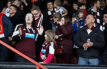 Hearts fans get the news that St Mirren have scored two late goals to relegate their team