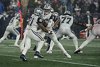 FOXBOROUGH, MA - NOVEMBER 24: Dallas Cowboys Quarterback Dak Prescott #4 hands the ball to Dallas Cowboys Runningback Ezekiel Elliott #21 during a game between Dallas Cowboys and New England Patriots at Gillettes on November 24, 2019 in Foxborough, Massachusetts.