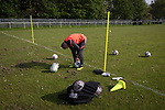 Denton 1 Winnington Avenue 1, 01/06/2021. Whittles Park, Cheshire League League 1. A member of the home club's background staff inflating footballs before Denton Town played Winnington Avenue in a Cheshire League, League 1 fixture at Whittles Park, Denton, Greater Manchester. Formed as Bradford Parish, they changed their name to its present one in 1994, relocated to the current ground the following year and stepped up to the Cheshire League in 2006. Watched by a crowd of 50 spectators, second-placed Denton could only draw this game 1-1, leaving them behind league leaders Knowsley South by five points with only three games each remaining. Photo by Colin McPherson.