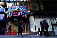 NEW YORK, NY - NOVEMBER 16: People pass by a souvenir store closed due to pandemic situation in Times Square on November 16, 2020 in New York. Some souvenir shops are closing and others struggling to survive the covid-19 pandemic, as no tourist visit NYC due to the virus surging again and many travel restrictions still in place, where international arrivals in main airports were down by 93 percent, according to Port Authority data. (Photo by Eduardo MunozAlvarez/VIEWpress)