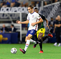 DALLAS, TX - JULY 25: James Sands #16 of the United States attempts to pass the ball during a game between Jamaica and USMNT at AT&T Stadium on July 25, 2021 in Dallas, Texas.