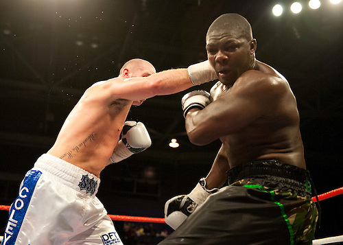 GLASGOW, SCOTLAND - MARCH 10: Stephen Simmons (white and blue shorts) lands a punch on Hastings Rasani (black shorts) in a Cruiserweight contest on the Ricky Burns undercard at the Braehead Arena on March 10, 2012 in Glasgow, Scotland. (Photo by Rob Casey/Getty Images)