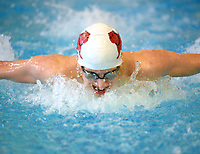 Springdale's Kevin Brumfield competes Saturday, Feb. 13, 2021, in the 100-yard butterfly during the Class 6A-West Conference Swim Championships at the Jones Center in Springdale. Visit nwaonline.com/210214Daily/ for today's photo gallery. <br /> (NWA Democrat-Gazette/Andy Shupe)