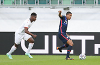 ST. GALLEN, SWITZERLAND - MAY 30: Reggie Cannon #20 of the United States passes off the ball during a game between Switzerland and USMNT at Kybunpark on May 30, 2021 in St. Gallen, Switzerland.