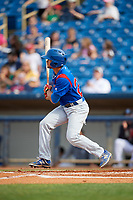 South Bend Cubs left fielder Zach Davis (22) follows through on a swing during the first game of a doubleheader against the Lake County Captains on May 16, 2018 at Classic Park in Eastlake, Ohio.  South Bend defeated Lake County 6-4 in twelve innings.  (Mike Janes/Four Seam Images)