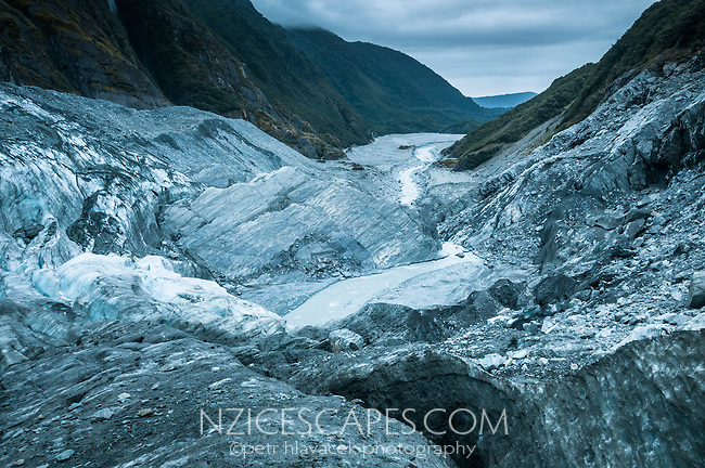 Looking toward Waiho valley and river from top of terminal icefall of Franz Josef Glacier at twilight, Westland National Park, West Coast, World Heritage, South Island, New Zealand