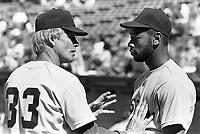 Boston Red Sox hitting coach Walt Hriniak talks with Red Sox outfielder Ellis Burks during a 1988 season game at Anaheim Stadium,in Anaheim,California.(Larry Goren/Four Seam Images)
