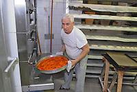 - bakery, making of a pizza....- forno per il pane, preparazione di una pizza