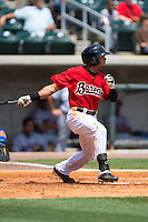 Jacob May (20) of the Birmingham Barons follows through on his swing against the Birmingham Barons at Regions Field on May 4, 2015 in Birmingham, Alabama.  The Barons defeated the Smokies 4-3 in 13 innings. (Brian Westerholt/Four Seam Images)