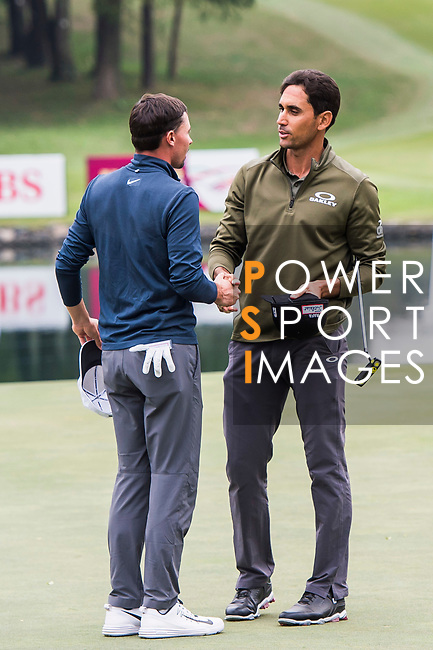 Rafa Cabrera Bello of Spain shakes hands with Paul Peterson of the United States during the day three of UBS Hong Kong Open 2017 at the Hong Kong Golf Club on 25 November 2017, in Hong Kong, Hong Kong. Photo by Marcio Rodrigo Machado / Power Sport Images