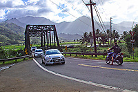 The north shore of Kaua'i is famous for its one-lane bridges. Crossing over the Hanalei River, this bridge continues a highway that has descended from the lookout elevations above.