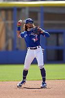 Toronto Blue Jays shortstop Austin Martin (80) throws the ball around the horn during a Major League Spring Training game against the Pittsburgh Pirates on March 1, 2021 at the TD Ballpark in Dunedin, Florida.  (Mike Janes/Four Seam Images)