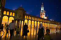 Locals walk through the Umayyad Mosque, in the Old Town district of Damascus, Syria.