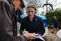 Gareth Ainsworth (Manager) of Wycombe Wanderers signs autographs after arriving for the Sky Bet League 2 match between Swindon Town and Wycombe Wanderers at the County Ground, Swindon, England on 21 October 2017. Photo by David Horn.
