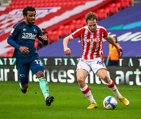 20th March 2021; Bet365 Stadium, Stoke, Staffordshire, England; English Football League Championship Football, Stoke City versus Derby County; Rhys Norringrton-Davies of Stoke City under pressure from  Nathan Byrne of Derby County