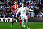 Real Madrid's Lucas Vazquez (r) and Atletico de Madrid's Diego Godin during La Liga match. April 8,2018. (ALTERPHOTOS/Acero)