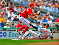 24 May 2009: Baltimore Orioles' right fielder Nick Markakis slides safely into third after hitting a 2 RBI triple in the third inning against the Washington Nationals at Nationals Park in Washington, DC. The Nationals rallied to defeat the Orioles 8-5 and salvage a win in their interleague series. Mandatory Credit: Ed Wolfstein Photo