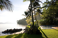 Private home in Parati Brazil. View looking out to the sea with morning steam rising from the pool.