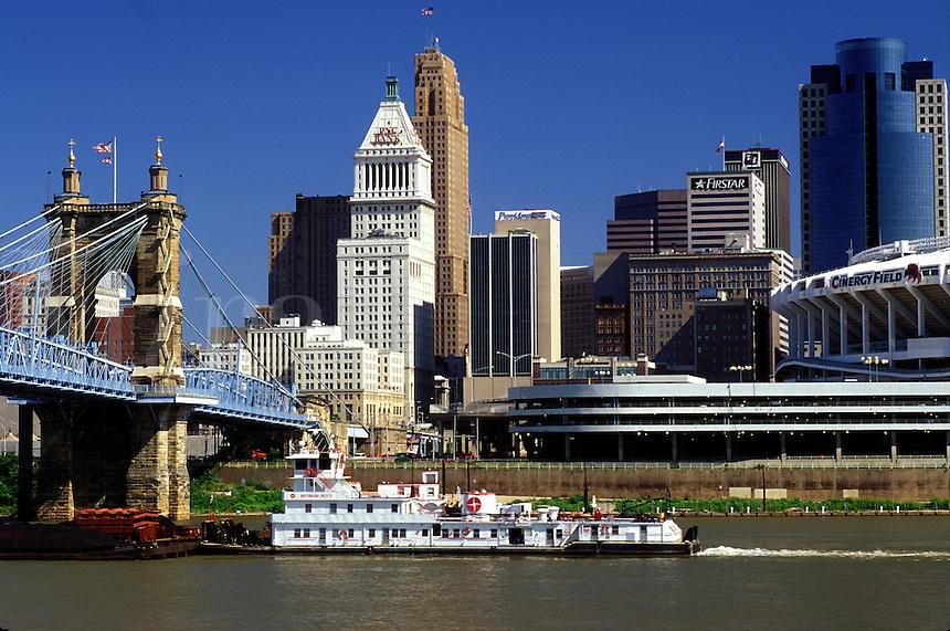Cincinnati, skyline, OH, Ohio, Downtown skyline of Cincinnati. Barge chugs along the Ohio River.