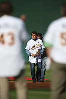 OAKLAND, CA - JULY 19:  Manager Tony La Russa #10 of the 1989 Oakland A's celebrates their World Series championship 25 years ago, before a game against the Baltimore Orioles at O.co Coliseum on July 19, 2014 in Oakland, California. La Russa is carrying a rose that he will lay down at the pitcher's mound in remembrance of Bob Welch, who died June 9. Photo by Brad Mangin