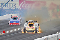 Feb 23, 2020; Chandler, Arizona, USA; NHRA funny car driver Jim Campbell (right) explodes an engine on fire alongside Robert Hight during the Arizona Nationals at Wild Horse Pass Motorsports Park. Mandatory Credit: Mark J. Rebilas-USA TODAY Sports