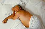 Les Dawson in bed for photo shoot for the BBC British Broadcasting Corporation. Jersey Chanel islands.