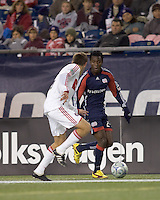 New England Revolution forward/midfielder Kenny Mansally (29) dribbles down the wing as Chicago Fire defender Brandon Prideaux (6) defends. The New England Revolution tied the Chicago Fire, 0-0, at Gillette Stadium on October 17, 2009.