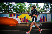 "NEW YORK, NY - AUGUST 4: A woman jogs next to water barriers used to prevent flooding at the South Street Seaport as city gets ready for tropical storm Isaias on August 4, 2020 in New York City. The Tri-State area ""New York, New Jersey and Connecticut"" is preparing for torrential rain, strong winds from Tropical storm Isaias. (Photo by Eduardo MunozAlvarez/VIEWpress)"