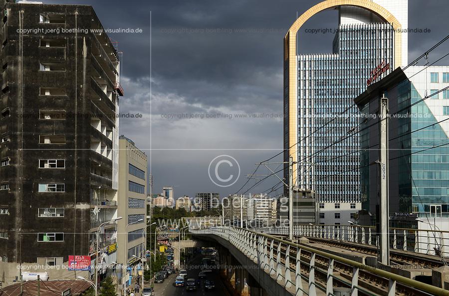 ETHIOPIA , Addis Ababa, LRT Light rail transport and office tower of Wegagen Bank, both build by chinese companies  / AETHIOPIEN, Addis Abeba, Stadtbahn Linie, und Gebaeude Wegagen Bank beides gebaut durch chinesische Firmen