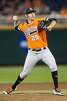 Oklahoma State Cowboys pitcher Trey Cobb (25) makes a pickoff throw to first base against the Arizona Wildcats during Game 6 of the NCAA College World Series on June 20, 2016 at TD Ameritrade Park in Omaha, Nebraska. Oklahoma State defeated Arizona 1-0. (Andrew Woolley/Four Seam Images)