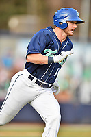 Asheville Tourists left fielder Casey Golden (11) runs to first base during a game against the Columbia Fireflies at McCormick Field on April 14, 2018 in Asheville, North Carolina. The Fireflies defeated the Tourists 7-6. (Tony Farlow/Four Seam Images)