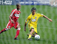 Columbus Crew forward Guillermo Barros Schelotto (7) maneuvers away from Chicago Fire defender Mike Banner (18). The Columbus Crew tied the Chicago Fire 2-2 at Toyota Park in Bridgeview, IL on September 20, 2009.