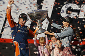 Scott Dixon, Chip Ganassi Racing Honda celebrates the championship with wife Emma and daughters Poppy and Tilly