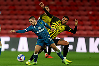 26th December 2020; Vicarage Road, Watford, Hertfordshire, England; English Football League Championship Football, Watford versus Norwich City; Emi Buendia of Norwich City is challenged by Etienne Capoue of Watford