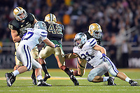 Kansas State linebacker JONATHAN TRUMAN (21) and  linebacker JARED LOOMIS (47) attempt to tackle Baylor inside receiver LEVI NORWOOD (42) during NCAA Football game at Floyd Casey Stadium in Waco, Texas. Baylor defeats number one Kansas State 52-24