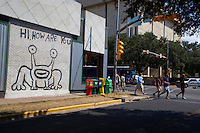 """""""Hi, How Are You?"""" frog (also known as """"Jeremiah the Innocent"""") a notable and famous Austin landmark in was painted in 1993, on the side of Sound Exchange located on the corner of 21st and Guadalupe (The Drag). Locals have successfully endeavored to preserve the image when the building subsequently changed ownership to a Baja Fresh restaurant and more recently to a restaurant called Crave. In Spring 2008, a Jeremiah the Innocent collectible figurine was released in limited runs of four different colors."""