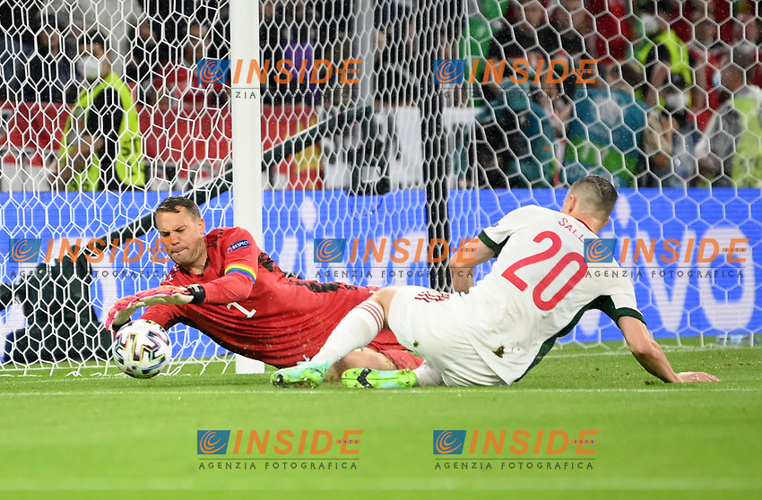 MUNICH, GERMANY - JUNE 23: Roland Sallai of Hungary stretches for the ball whilst under pressure from Manuel Neuer of Germany during the UEFA Euro 2020 Championship Group F match between Germany and Hungary at Allianz Arena on June 23, 2021 in Munich, Germany. (Photo by Sebastian Widmann - UEFA/UEFA via Getty Images)<br /> Photo Uefa/Insidefoto ITA ONLY