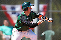Dartmouth Big Green shortstop Nate Ostmo (19) squares to bunt during a game against the Eastern Michigan Eagles on February 25, 2017 at North Charlotte Regional Park in Port Charlotte, Florida.  Dartmouth defeated Eastern Michigan 8-4.  (Mike Janes/Four Seam Images)