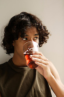 Model Released photo of a 18 year old mixed (asian and african-american) teenager drinking beer in Montreal Canada<br /> <br /> <br /> photo : Roussel  - Images Distribution