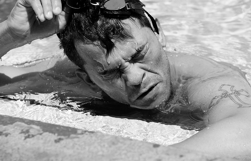 ARTURO GATTI (7/12) --Boxer Arturo Gatti pulls off his goggles after swimming laps as part of his conditioning regiment for his June 25th fight against Floyd Mayweather in Atlantic City.  The swimming will make Gatti's back stronger, so he can stay low throughout the fight, conditioner Teddy Cruz said.  (4/12/05)  VERO BEACH, FL