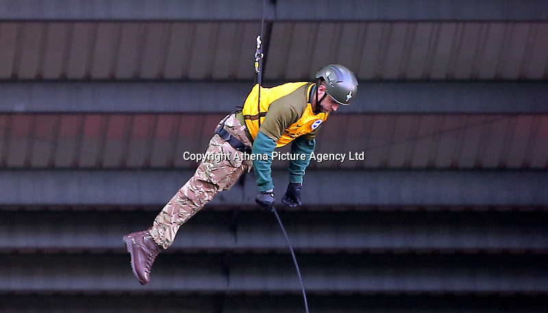 A member of the armed forces abseils from the roof during the Premier League match between Swansea City and Brighton and Hove Albion at The Liberty Stadium, Swansea, Wales, UK. Saturday 04 November 2017