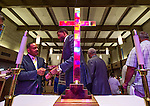 BATON ROUGE, LA -JULY 07:  The stain glass windows reflect in a cross as Together Baton Rouge member, Dr Joe Connelly, left, networks after his group's press conference about the federal investigation into the shooting of Alton Sterling at the Wesley United Methodist Church in downtown Baton Rouge July 7, 2016. Sterling was shot and killed by police on July 5, 2016 in Baton Rouge, Louisiana. (Photo by Mark Wallheiser/Getty Images)