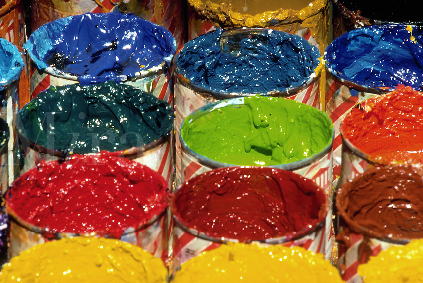 Paint cans with many different colors of paint.