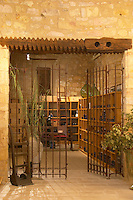 The chapel converted into tasting room and wine shop. Domaine Mas Gabinele. Faugeres. Languedoc. The gate. The wine shop and tasting room. France. Europe.