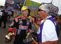 Mar 15, 2015; Gainesville, FL, USA; Photographer Jon Asher (right) congratulates NHRA pro stock driver Greg Anderson after winning the Gatornationals at Auto Plus Raceway at Gainesville. Mandatory Credit: Mark J. Rebilas-