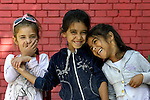 """THIS PHOTO IS AVAILABLE AS A PRINT OR FOR PERSONAL USE. CLICK ON """"ADD TO CART"""" TO SEE PRICING OPTIONS.   Roma girls laughing in the Nasa Radost preschool in Smederevo, Serbia."""
